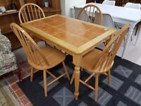 Solid used kitchen tile top table and 4 chairs