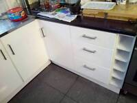 Gloss white wickes kitchen units - with plinth, doors, handles, and worktops