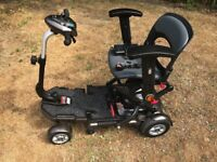Minimo Plus 4 - folding compact mobility scooter. It has done less than 500 metres and is unused.