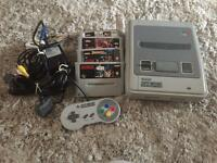 Super Nintendo snes with 4 games and all wires. NEED SOLD