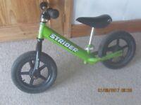 Children kids Strider balance Bike green good condition