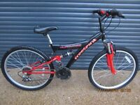 CHILS FREESPIRIT SUSPENSION BIKE IN ALMOST NEW CONDITION.. (SUIT APPROX. AGE. 8+)..