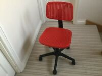 Red Ikea swivel chair