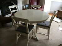 Ikea white round extendable tables and chairs