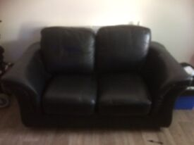 2 seater leather and 2 chairs