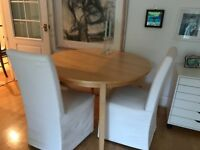 Dining table and 2 Chairs with fabric covers