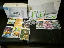 Boxed Nintendo Wii with boxed Wii fit board in Excellent condition with 11 games