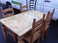 Wooden dinning table and 4 chunky wooden chairs
