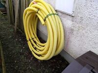 150m COIL OF 60mm PLASTIC HAYES LAND DRAINAGE PERFORATED PIPING IN EXCELLENT CONDITION