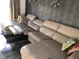 Leather sofa recliner in centre