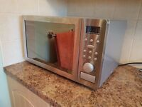 COMBINATION MICROWAVE OVEN WITH GRILL 25 LTRE RUSSELL HOBBS SILVER 1 YR OLD