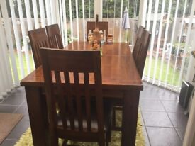 Solid heavy wood extendable dinning table and six chairs