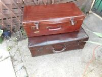 two vintage brown suit cases for storage or display