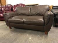 As new 2 small brown leather 2 seater sofas