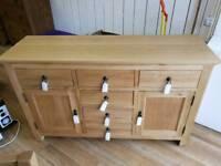 Solid oak sideboard 6 drawers and shelves inside (corner slightly damaged)
