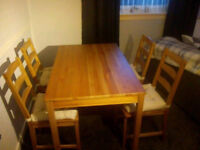 Dinning table with four chairs with cushions