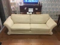 Large 4 seater cream sofa
