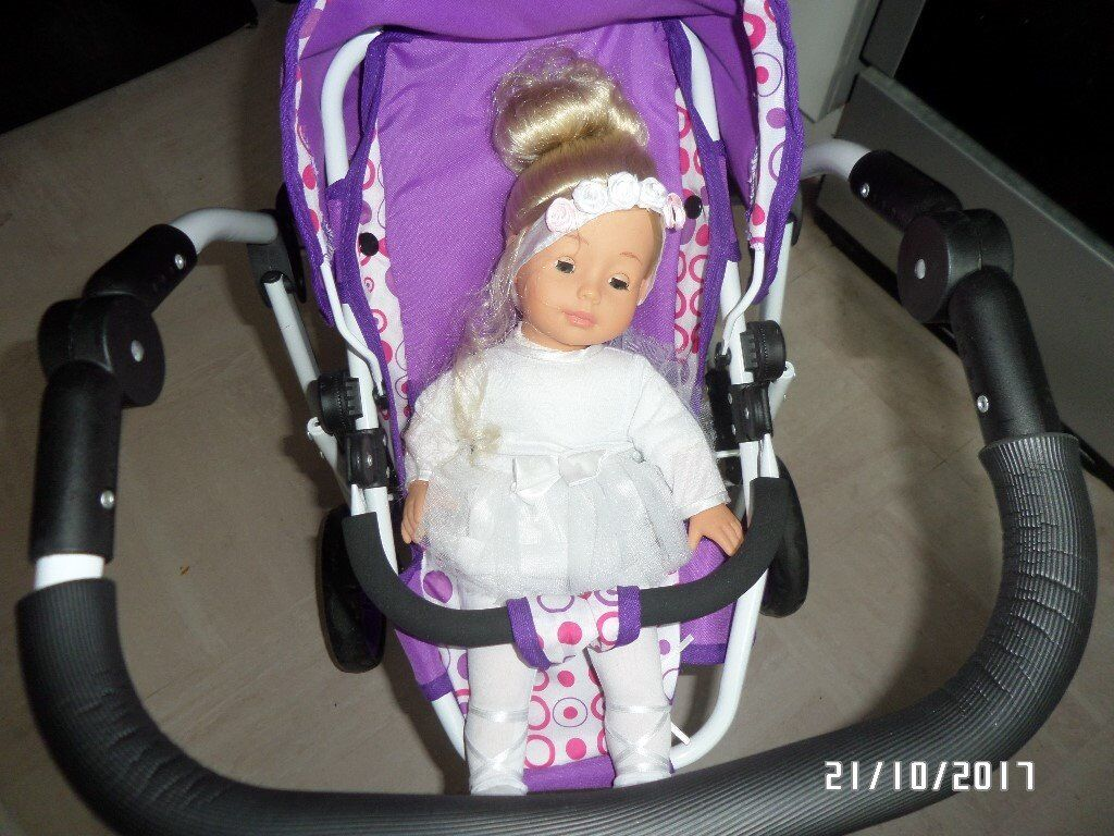 a kid double push chair with dolls included