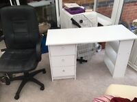 White desk and black office swivel chair.