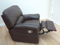 BROWN LEATHER LAZY BOY RECLINING CHAIR .