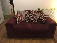 2x 2 seater Sofas. Plumb in colour. Good used condition- the odd mark but still very comfortable.