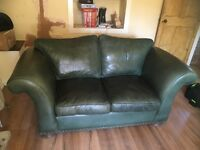 Two seater green leather sofa