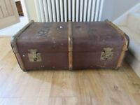 Vintage leather trunk with wooden strapping