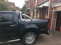 ROLL N LOCK bed cover and sports bar Toyota Hilux Double cab