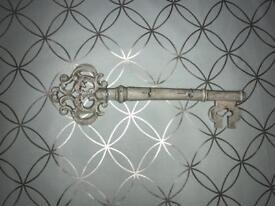 Large antique white decorative large key with small hooks to hold keys