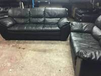 Like new dazzling Black 2 and 3 seater sofas
