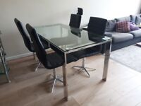 Glass Dining Table and 6 swivel chairs