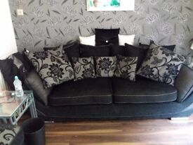 3 seater black fabric sofa with matching large poufee