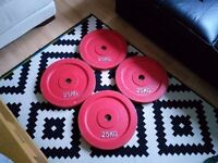 4 x 25kg red bumper olympic weight plates