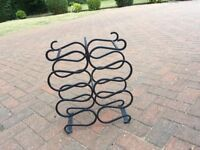 Modern black steel wine rack. Holds 12 bottles