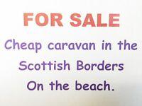 Static caravan for sale next to sandy beach Berwickshire.Site fees paid until 2018 season. Bargain!