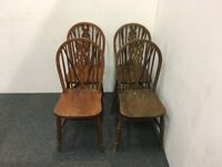 Four Solid Wood Wheel-Back Dining Chairs