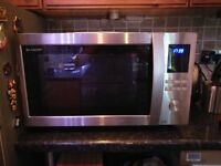 Sharp combination microwave and grill for sale in fantastic condition.