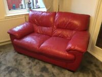 Red Leather 3 and 2 seater sofa for sale.