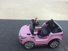 Pink Rapid Racer electric toy ride on car