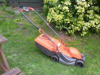 FLYMO rotary mower.
