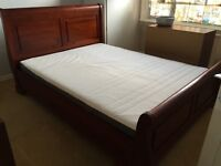 King size solid dark wood sleigh bed