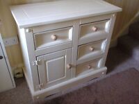 A painted solid pine sideboard