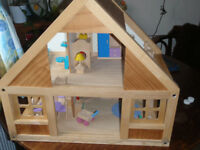 Large wooden well made dolls house with wooden furniture. ELC ?