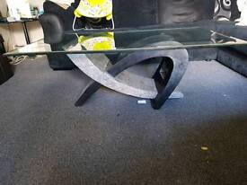 Black and gray glass retro coffee table.
