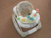 Musical Play tray, Walker and Rocker all in one.