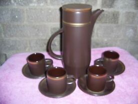 Purbeck Pottery coffee pot and four coffee cans.