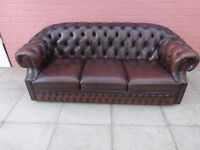 A Dark Brown Leather Chesterfield Three Seater Sofa