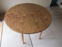 "Round drop leaf wood grained table 42"" x 27"""
