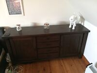 Solid dark wood sideboard, 4 drawers and 2 cupboards. RRP. £899 Willing to sell for £250