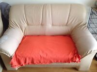 Free cream leather sofa.